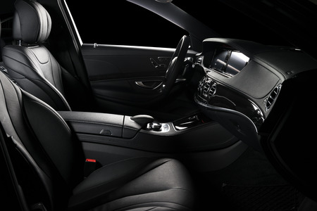 Modern luxury car  black leather interior, dashboard and comfortable seats, clipping path for windows included.