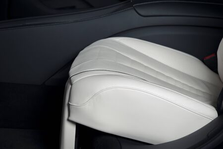Back passenger seats in modern luxury car, details of car seat white leather