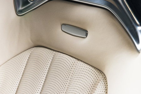Modern race car  white perforated leather interior. Part of  leather car seat details.