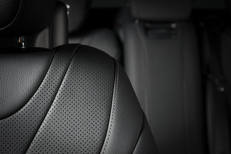Modern  luxury car  black leather interior. Part of  leather car seat details.