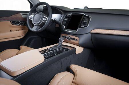 Modern luxury prestige car interior, dashboard, steering wheel. Orange red perforated leather interior. Stock Photo