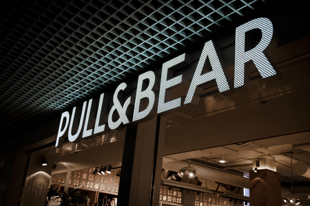 Arhangelsk, Russia - 16 December 2017: PULL & BEAR retail clothing boutique in Titan Arena mall shoping area. Pull & Bear is a Spanish clothing and accessories retailer. Part of Inditex group.
