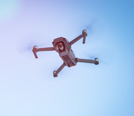 Drone flying in the blue sky, unmanned copter flight,  Archivio Fotografico
