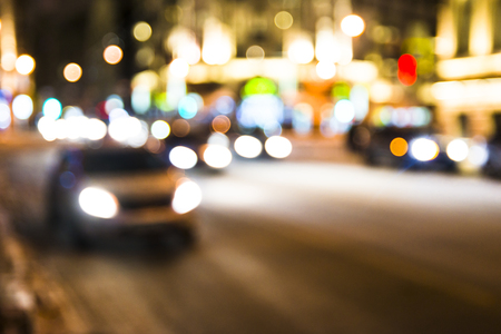 Blurred Photo, cityscape at twilight time, Traffic lights of the night city road. Archivio Fotografico
