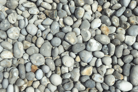 All rounded tiny pebbles from beach, a natural summer background, smooth polished pebble stones Standard-Bild - 109611271