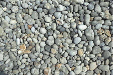 All rounded tiny pebbles from beach, a natural summer background, smooth polished pebble stones Standard-Bild - 109611275