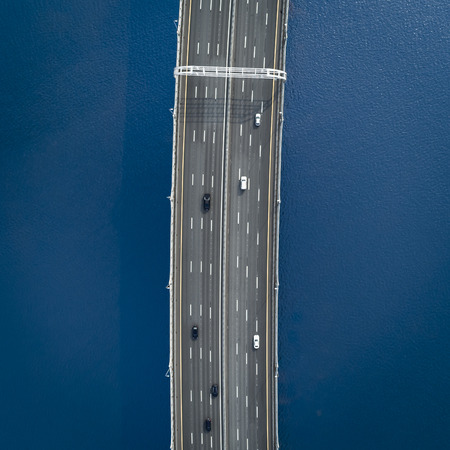Aerial view of a high way road on the bridge. top view, isolated on black, black and white photography Standard-Bild - 109577803