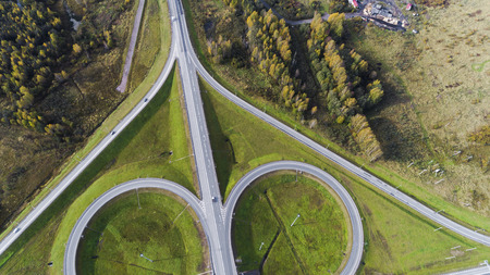 Aerial view of highway interchange  Road junction Aerial photo of a highway going through the forest Standard-Bild - 109577830