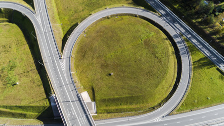 Aerial view of highway interchange  Road junction Aerial photo of a highway going through the forest Standard-Bild - 109577954