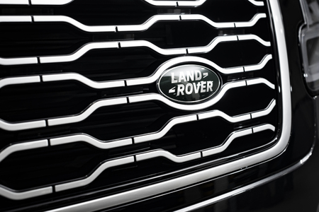 London, Great Britain - February 22, 2019: New Land Rover Range Rover luxury SUV cars, front radiator enclosure grille logos. Editorial
