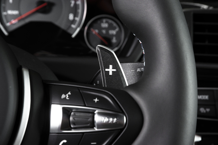 Control buttons on the steering wheel, modern luxury car interior details
