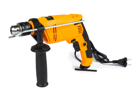 Brand new, yellow color, impact drill, isolated on white background, studio shot