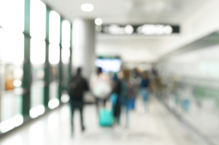 Blurred background, travelers with baggage at terminal departure check-in at airport with bokeh light, transportation concept