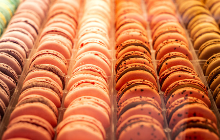 Colorful french macarons background, close up. Different colorful macaroons background. Tasty sweet color macaron, Bakery concept. Selective focus Banco de Imagens