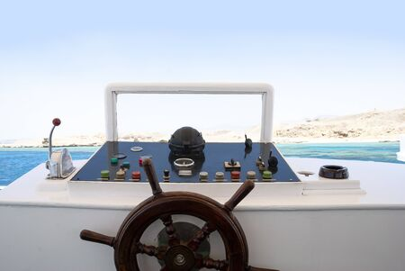 Control panel and helm on sailing boat