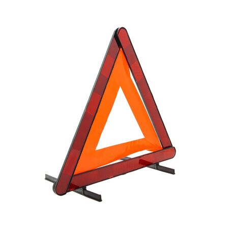 Emergency reflective car warning triangle used to warn others of a broken down vehicle, a legal requirement in most European countries, isolated on a white background