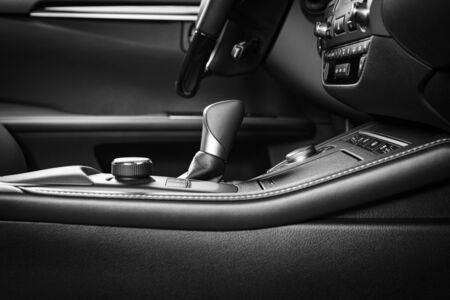 Modern luxury car Interior - steering wheel, shift lever and dashboard. Car interior luxury inside.