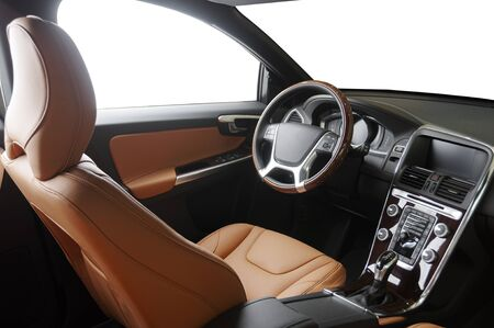Orange red sand leather luxury car inside Interior - steering wheel, shift lever and dashboard.