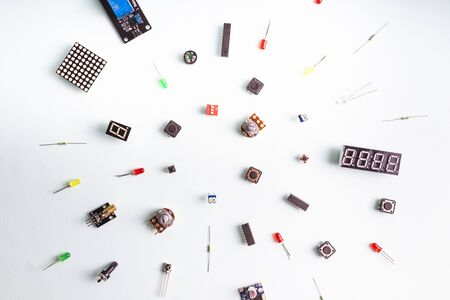 Micro electronics arduino DIY components on a light background, top view, copy space. Microcontrollers, boards, sensors, leds, controllers