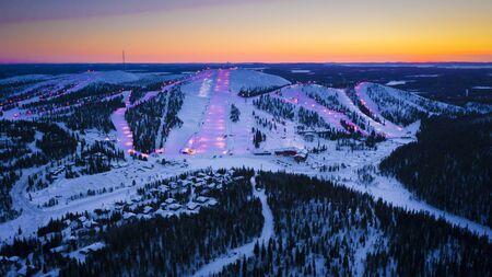 Ruka ski resort slopes. Ruka, Finland, aerial view forest mountains with ski resort