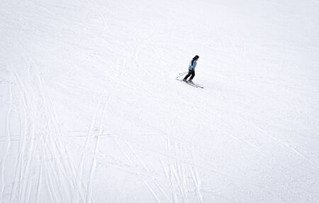 Man skiing alone on a ski slope in mountain