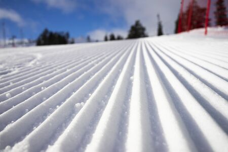 Ready ski piste after snow cat and snow grooming with velvet texture 版權商用圖片