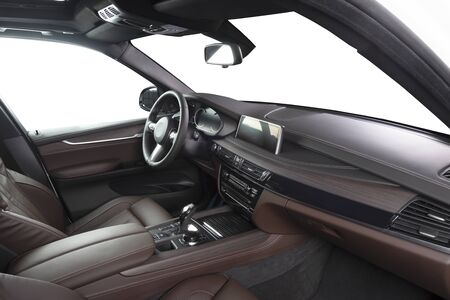 Orange red sand leather luxury car inside Interior - steering wheel, shift lever and dashboard. Imagens