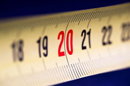 yellow metall tape measure close up macro shot red 20 twenty