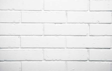 Old white brick wall background texture close up shot