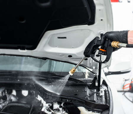Car detailing maintenance, cleaning engine with the high pressure cleaner