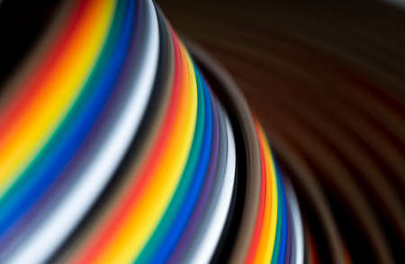 Cable and wires rainbow colored blurred close-up, macro shot, Texture or background. wires color background Archivio Fotografico