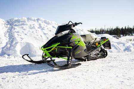 Ruka Finland 20 March 2020: Snow mobile Arctic Cat cross Country XF6000 on the snow Editorial