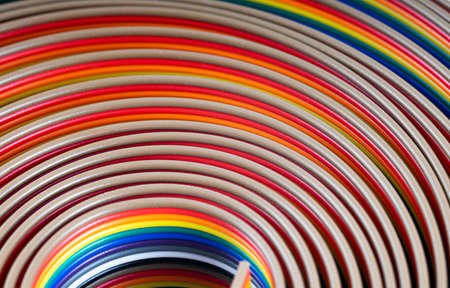 Cable and wires rainbow colored blurred close-up, macro shot, Texture or background. wires color background Standard-Bild
