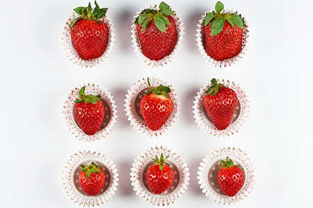 Ripe strawberries in baskets on a white background