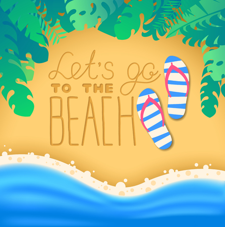 Lettering lets go to the beach written on sand on beach with tropical leaves