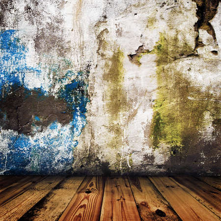 grunge painted wall and wooden floor in a room