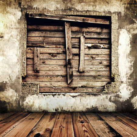 room in an old house with boarded up window