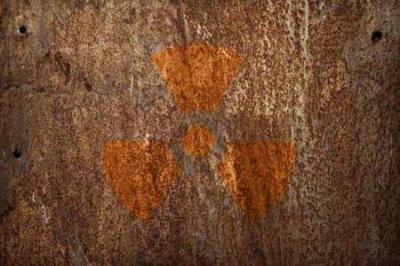 radioactive warning symbol: nuclear radiation sign on rusty metal texture