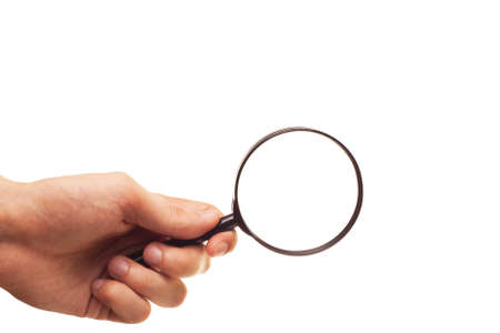 hand with magnifying glass isolated on white background Stock Photo - 7664746