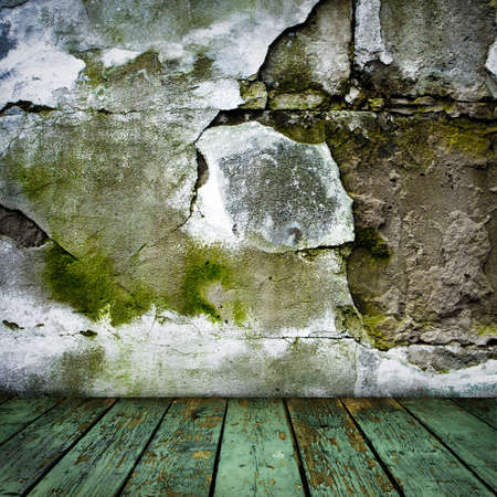 grunge painted cracked wall and wooden floor in a room photo