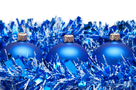 blue christmas balls with tinsel isolated over white background Stock Photo - 8328768