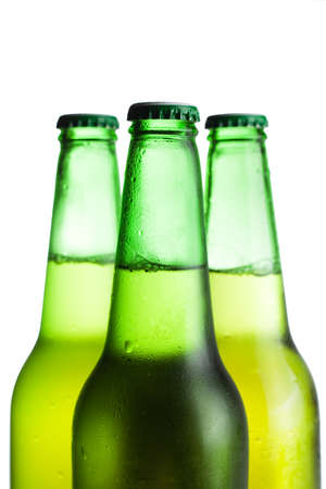 three green beer bottles isolated over white Stock Photo - 8481827