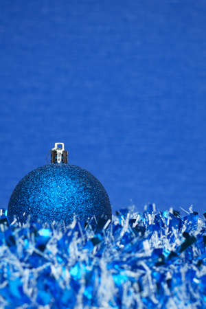 blue shiny christmas ball with tinsel Stock Photo - 8512603