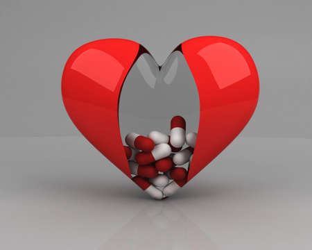 pilule: transparent heart with pills inside over grey background