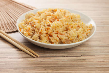 brown rice: bowl of cooked rice with chopsticks