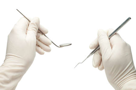 hands of dentist holding his tools during patient examination isolated Stock Photo