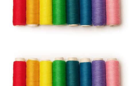 rainbow colored threads set isolated over white background photo