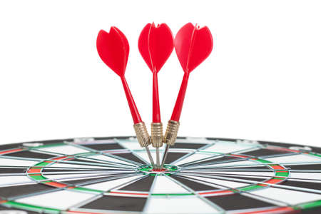 three darts hit the dead centre of target Фото со стока