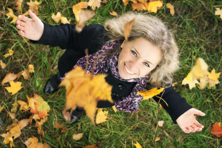 happy girl under the tree with falling leafs photo