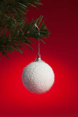 white christmas ball hanging on artificial christmas tree Stock Photo - 11310772